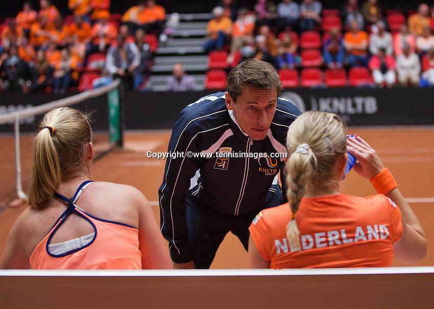 Netherlands, Den Bosch, April 18 2015 Maaspoort, Fedcup Netherlands-Australia,  Doubles:     Michaëlla Krajicek and Richel Hogenkamp (NED) with captain Paul Haarhuison the bench
