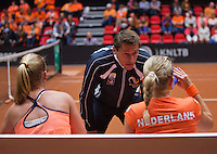 Netherlands, Den Bosch, April 18 2015 Maaspoort, Fedcup Netherlands-Australia,  Doubles:     Michaëlla Krajicek and Richel Hogenkamp (NED) with captain Paul Haarhuison the bench