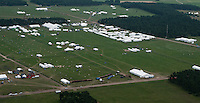 The two subcamps Summer (back) and Autumn (front) are empty before the participants arrive. You can see a cluster of white tents in the middle where the town centres are situated. Between the subcamps are the Common Areas with the Four Seasons Square, the Jamboree Shop and the grand Central Tower. Photo: Eric Hampusgård/Scouterna