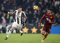 Calcio, Serie A: Juventus vs Roma. Torino, Juventus Stadium,17 dicembre 2016. <br /> Juventus&rsquo; Mario Mandzukic, left, and Roma&rsquo;s Emerson Palmieri fight for the ball during the Italian Serie A football match between Juventus and Roma at Turin's Juventus Stadium, 17 December 2016.<br /> UPDATE IMAGES PRESS/Isabella Bonotto
