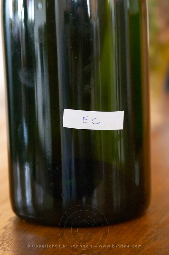 A bottle with a small scotched label saying EC meaning Essence de Cognac. This is cognac of 70% strength (undiluted) that is used in small quantities to mix in the liqueur d'expedition (that is used to fill the bottle after disgorging). It is aged one year in barrel and has a wonderful fresh and fruity aromatic character, much different from old cognacs that sometimes are over-oaked Champagne Duval Leroy, Vertus, Cotes des Blancs, Champagne, Marne, Ardennes, France, low light grainy grain