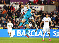 SWANSEA, WALES - FEBRUARY 07: L-R Jack Cork of Swansea clashes mid-air against Jordi Gomez during the Premier League match between Swansea City and Sunderland AFC at Liberty Stadium on February 7, 2015 in Swansea, Wales.