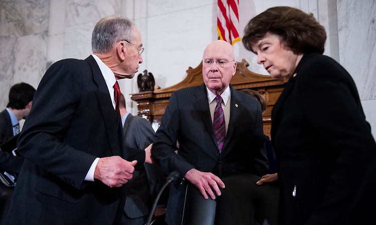 UNITED STATES - JANUARY 10: From left, chairman Sen. Chuck Grassley, R-Iowa, Sen. Patrick Leahy, D-Vt., and ranking member Sen. Dianne Feinstein, D-Calif., confer before the start of the Senate Judiciary Committee confirmation hearing of Sen. Jeff Sessions to be Attorney General in the Trump administration on Tuesday, Jan. 10, 2017. (Photo By Bill Clark/CQ Roll Call)