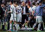 Coach Zinedine Zidane of Real Madrid gives instructions to the players as Daniel Carvajal Ramos of Real Madrid is helped up during their 2016-17 UEFA Champions League Quarter-finals second leg match between Real Madrid and FC Bayern Munich at the Estadio Santiago Bernabeu on 18 April 2017 in Madrid, Spain. Photo by Diego Gonzalez Souto / Power Sport Images