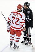 Ross Gaudet (BU - 22) and Chris Rooney (PC - 21), former teammates with the Bridgewater Bandits (EJHL) chatted after the game. There was no handshake line, a decision made by the Providence players in the absence of their captain who had been given a game misconduct early in the third. - The Boston University Terriers defeated the visiting Providence College Friars 6-1 on Friday, January 20, 2012, at Agganis Arena in Boston, Massachusetts.