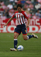 Chivas USA forward Ante Razov dribbles kicks the ball upfield. Chivas USA beat Real Salt Lake at the Home Depot Center 3-0 in Carson, Calif. on April 2, 2006.