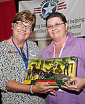 Conference attendee presents Jennifer M. Cernock, President of the Texas Chapter- Operation Homefront with a toy at the Texas Conference for Women 2010. Your Time is Now!
