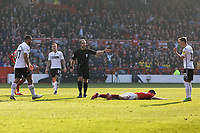 Referee Jeremy Simpson (C) awards a free kick after a foul by Cameron Carter-Vickers of Swansea City (L) to Joe Lolley of Nottingham Forest who lays on the pitch during the Sky Bet Championship match between Nottingham Forest and Swansea City at City Ground, Nottingham, England, UK. Saturday 30 March 2019