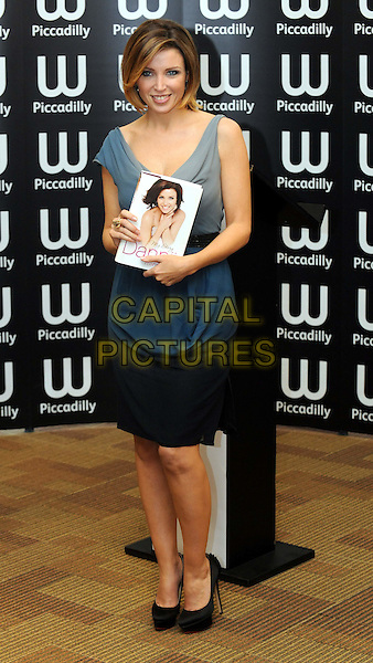DANNII MINOGUE.Signing her book 'Dannii: My Story' at Waterstone's, Piccadilly, London, England.October 29th, 2010.booksigning full length blue grey gray cowel neck sleeveless highlights hair dress black.CAP/WIZ.© Wizard/Capital Pictures.