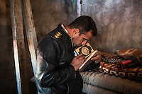IRAK, Karqasha; A peshmerga fighter is looking and smelling at a Coran left by a militant of Daesh in one of the house where they used to live, in the town of Sheik Amir, the 6th December 2016. <br /> <br /> IRAK, Karqasha; Un combattant peshmerga regarde et sent un Coran laiss&eacute; par un militant de Daesh dans une des maisons o&ugrave; ils ont v&eacute;cu, dans la ville de Sheik Amir, le 6 d&eacute;cembre 2016.
