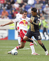 Michael Oroxco #16 of the Philadelphia Union gets the ball away from Mike Petke #12 of the New York RedBulls during a MLS  match on April 24 2010, at RedBull Arena, in Harrison, New Jersey.