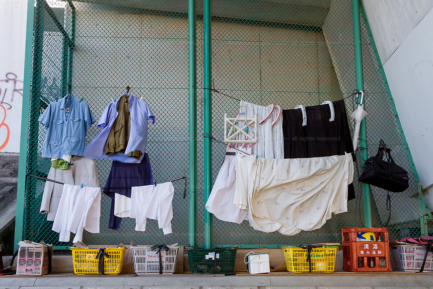 The laundry of a homeless man dries under a bridge along the side of the Tamagawa River near Tamagawa, Tokyo, Japan, Friday December 14th 2018