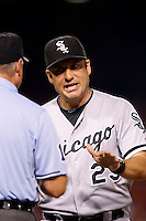Chicago White Sox Manager Robin Ventura #23 argues with umpire Ed Hickox during a game against the Los Angeles Angels at Angel Stadium on September 22, 2012 in Anaheim, California. Los Angeles defeated Chicago 4-2. (Larry Goren/Four Seam Images)