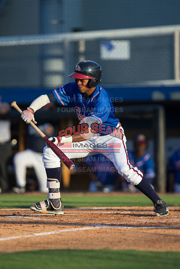 Isranel Wilson (9) of the Danville Braves attempts to lay down a bunt during the game against the Kingsport Mets at American Legion Post 325 Field on July 9, 2016 in Danville, Virginia.  The Mets defeated the Braves 10-8.  (Brian Westerholt/Four Seam Images)