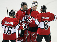 University of Nebraska Omaha's Johnnie Searfoss, Brent Gwidt and Pasko Skarica celebrate with goalie John Faulkner after beating North Dakota. No. 4 UNO beat No. 7 North Dakota 1-0 Saturday night at Qwest Center Omaha. (Photo by Michelle Bishop)