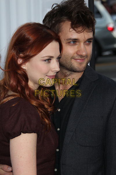 Alexandra Breckenridge & guest.The L.A. Premiere of 'Ted' held at The Grauman's Chinese Theatre in Hollywood, California, USA..June 21st, 2012.half length dress black brown profile stubble facial hair grey gray.CAP/ADM/RE.©Russ Elliot/AdMedia/Capital Pictures.