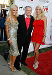 "Bridget Marquardt, Hugh Hefner and Holly Madison arrive at the Much Love Animal Rescue Presents The Second Annual ""Bow Wow WOW!"" at The Playboy Mansion on July 19, 2008 in Beverly Hills, California."