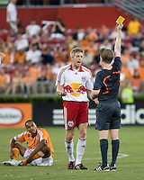Referee Andrew Chapin shows New York Red Bulls forward John Wolyniec (15) the yellow card caution in the 37th minute for a tackle from behind on Houston Dynamo midfielder Ricardo Clark (13).  Houston Dynamo defeated  New York Red Bulls 1-0 at Robertson Stadium in Houston, TX on May 31, 2008.