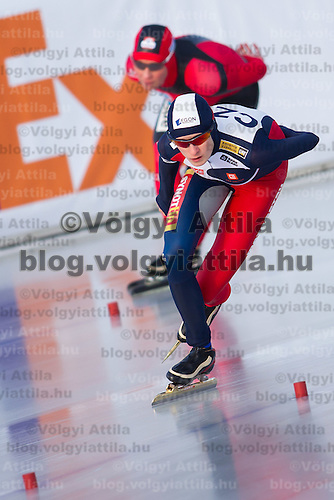 Czech Republic's Martina Sablikova (front) and Germany's Claudia Pechstein (back) compete in Women's 5000m race of the Speed Skating All-round European Championships in Budapest, Hungary on January 8, 2012. ATTILA VOLGYI