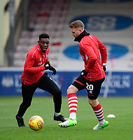 Lincoln City's Bernard Mensah, left, with team-mate James Brown during the pre-match warm-up<br /> <br /> Photographer Chris Vaughan/CameraSport<br /> <br /> The EFL Sky Bet League Two - Lincoln City v Grimsby Town - Saturday 19 January 2019 - Sincil Bank - Lincoln<br /> <br /> World Copyright © 2019 CameraSport. All rights reserved. 43 Linden Ave. Countesthorpe. Leicester. England. LE8 5PG - Tel: +44 (0) 116 277 4147 - admin@camerasport.com - www.camerasport.com