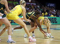 17.10.2012 Australia's Renae Hallinan and South Africa's Nokuthula Qegu in action during the Australia v South Africa netball test match as part of the Quad Series played in Newcastle Australia. Mandatory Photo Credit ©Michael Bradley.