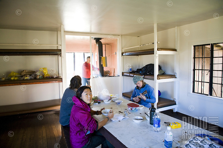Hikers eating breakfast in their cabin in the Haleakala Crater