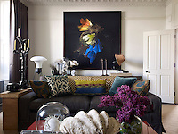 In the living room, a photograph by Mat Collishaw a Zandberg designed sofa upholstered in Zimmer and Rohde cotton, and a candelabra by Hersov's partner, Barry Reigate
