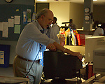 Jim Dooley working in Newsday newsroom in operation during Blackout on Thursday August 14, 2003. (Photo / Jim Peppler).