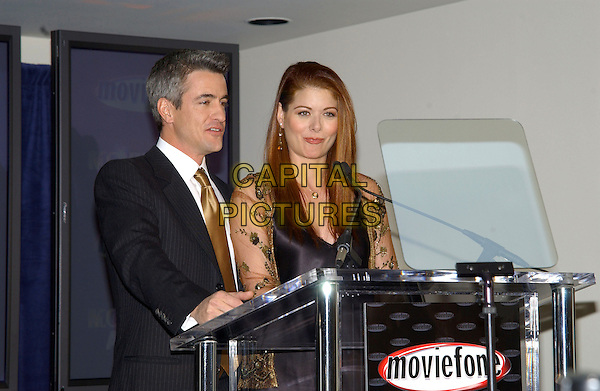 DERMOT MULRONEY & DEBRA MESSING.10th Annual Moviefone Moviegoer Awards Nominations held at The Regent Beverly Wilshire Hotel, Beverly Hills, California.January 20th, 2005.Photo Credit: Jacqui Wong/AdMedia.half length, green sheer sleeves, funny face, podium, speech.www.capitalpictures.com.sales@capitalpictures.com.© Capital Pictures.