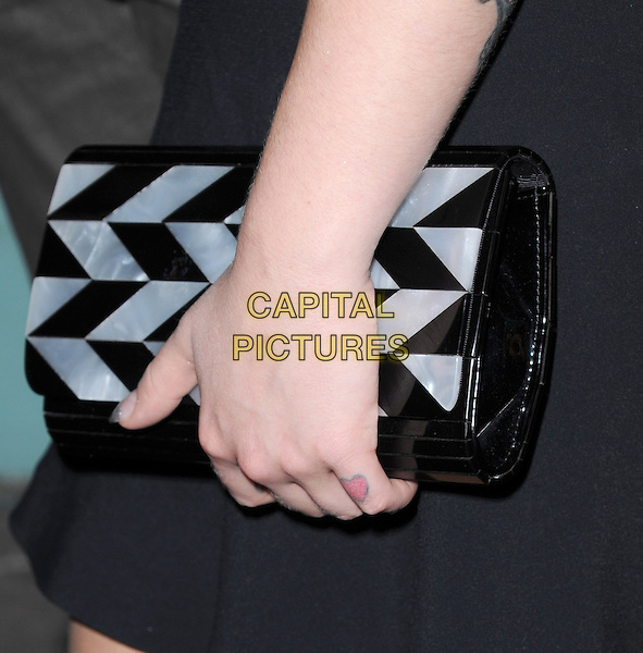 Kelly Osbourne's bag<br /> The Myspace Event held at The El Rey Theatre in Los Angeles, California, USA.<br /> June 12th, 2013   <br /> detail clutch handblack white <br /> CAP/DVS<br /> &copy;DVS/Capital Pictures