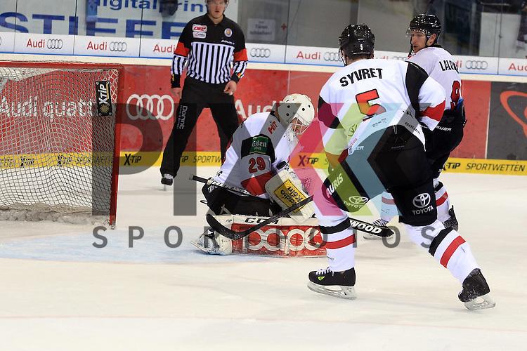 29 Gustaf Wesslau (Torwart Koelner Haie) h&auml;lt Torschuss von ERC Ingolstadt mit auf dem Bild 5 Daniel Syvret (Spieler K&ouml;lner Haie) und 9 Shawn Lalonde (Spieler Koelner Haie) beim Spiel in der DEL, ERC Ingolstadt (blau) - Koelner Haie (weiss).<br /> <br /> Foto &copy; PIX-Sportfotos *** Foto ist honorarpflichtig! *** Auf Anfrage in hoeherer Qualitaet/Aufloesung. Belegexemplar erbeten. Veroeffentlichung ausschliesslich fuer journalistisch-publizistische Zwecke. For editorial use only.
