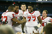 January 5th, 2008:  MVP Ray Rice (27) shares the MVP award with llineman Jeremy Zuttah (71), Mike Fladell (back), Pedro Sosa (77), and Mike Teel (14) after the International Bowl at the Rogers Centre in Toronto, Ontario Canada...Rutgers defeated Ball State 52-30.  ..Photo By:  Mike Janes Photography