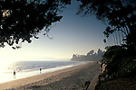 People walking on sand at Butterfly Beach, Santa Barbara, California
