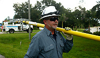 Florida Power & Light Company employee Adam Collins, of Fort Myers, works to re-fuse the lateral line to restore power to between 60 to 80 residents after a storm possibly associated with the outer bands of Hurricane Irma dropped a palm frond on the line nearby  on September 8, 2017 in Fort Myers, FL. (Photo By Brian Blanco/Florida Power & Light Co.)