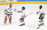 Nebraska-Omaha goalie Dayn Belfour and Alex Hudson (26) celebrate Matt White's (21) goal. St. Cloud State and Nebraska-Omaha skated to a 2-2 tie on Nov. 27, 2011. (Photo by Michelle Bishop)..