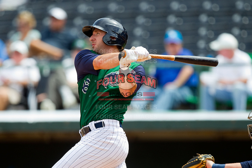 Brent Morel (26) of the Charlotte Knights follows through on his swing against the Durham Bulls at Knights Stadium on August 18, 2013 in Fort Mill, South Carolina.  The Bulls defeated the Knights 8-5 in Game One of a double-header.  (Brian Westerholt/Four Seam Images)