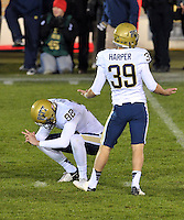 Pittsburgh Panthers kicker Kevin Harper (39) reacts to missing what would have been the game-winning field goal in the second overtime.