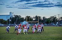 The Greeley County High School football team, the Tribune Jackrabbits, during an eight man football game in Tribune, Kansas, Friday, October 13, 2013. The challenges of depopulation in the rural Midwest and Great Plains continue to grow as counties increasingly see more deaths than births. Greeley County, Kansas's least populated county, and the state as a whole are mounting a new fight to stem losses and finding early success. <br /> <br /> Photo by Matt Nager
