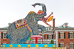 "Red Grooms sculpture ""Jumbo"" a large outdoor sculpture of Circus Elephant with Tamer and Acrobat, on grounds of Nassau County Museum of Art with brick mansion ""Arnold and Joan Saltzman Fine Art Building"" in background, Roslyn Harbor, Long Island, New York, May 24, 2009. Seen from rear, the American artist's 2001 enamel on aluminum 116 x 109 1/2 x 45 inches sculpture of Circus Elephant Tamer and woman Acrobat (Editorial Use Only)"