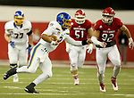 VERMILLION, SD - NOVEMBER 18: Taryn Christion #3 from South Dakota State University scrambles for yardage past Kameron Cline #92 from the University of South Dakota during their game Saturday afternoon at the DakotaDome in Vermillion. (Photo by Dave Eggen/Inertia)