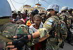 United Nations troops from Argentina keep the crowd back from a distribution of emergency supplies by Caritas Internationalis and Diakonie, a member of the ACT Alliance, in the Haitian city of Leogane. Hundreds of families in the town are homeless following a January 12 earthquake, and the two church-sponsored agencies worked together to bring them help. The aid groups organized an air cargo shipment of 34 tons of relief supplies from Europe, along with basic medicines for 80,000 people. The plane wasn't allowed to land in Port-au-Prince until January 20, yet it was unloaded within hours and aid was shipped immediately hours to Leogane in United Nations trucks, where it was unloaded by residents and quickly distributed.