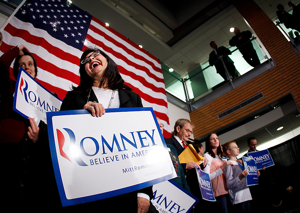 Gov. Mitt Romney supporter Margo Nahas of Adel, Iowa waits for the arrival of New Jersey Gov. Chris Christie at the outset of a rally in support of Gov. Mitt Romney Wednesday evening, December 7, 2011 in West Des Moines, Iowa. (Christopher Gannon/MCT)