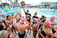5 November 2011:  FIU's team celebrates after the FIU Golden Panthers won the meet with the Florida Atlantic University Owls and Florida Southern Moccasins at the Biscayne Bay Campus Aquatics Center in Miami, Florida.