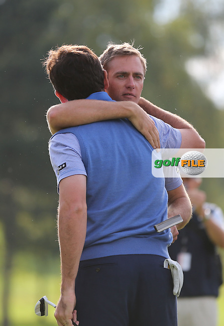 Team Continental Europe's Nicolas Colsaerts (BEL) bear hugs playing partner Gonzalo Fdez-Castano (ESP) as they defeat Team GB & Ireland's Marc Warren (SCO) and Scott Jamieson (SCO) 5&3 during the Fourball Matches on Day One at the Seve Trophy by Golf+ 2013, from Saint-Nom-La-Breteche, Paris, France. Picture:  David Lloyd / www.golffile.ie