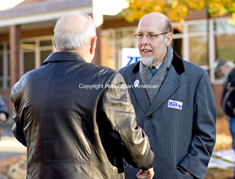 SOUTHINGTON, CT-02 November 2010-110210BF01-- Joe Markley, Republican candidate for the 16th Senate District greets an unidentified voter outside the polling station at John F. Kennedy Middle School in Southington Tuesday afternoon. Markley is running against Democrat John Barry for the seat vacated by Sam Caligiuri. The 16th District serves Southington, Cheshire, Wolcott and Waterbury.<br /> Bob Falcetti Republican-American