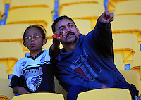 Fans watch the international AFL match between NZ Hawks and Australian AFL Rising Stars Academy at Westpac Stadium, Wellington, New Zealand on Friday, 24 May 2015. Photo: Dave Lintott / lintottphoto.co.nz