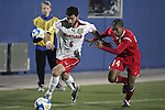 12 December 2008: Rich Costanzo (6) of Maryland beats Walter Hines (24) of St. John's to a loose ball.  The University of Maryland Terrapins defeated the St. John's University Red Storm 1-0 during the second sudden death overtime at Pizza Hut Park in Frisco, TX in an NCAA Division I Men's College Cup semifinal game.