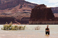 Cyclist Susan DeLisle, of New York, cools down on the waters of Lake Powell at the end of teh 408-mile adventure, July 2, 2010. The Red Rock Canyons Tour, organized by Lizard Head Cycling Tours, wound through 400 miles of the desert southwest. The route traveled through canyons and national monuments in Colorado, Utah and Arizona, ending at Lake Powell. (Kevin Moloney for the New York Times)