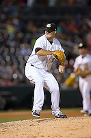 Charlotte Knights relief pitcher Jarrett Casey (10) in action against the Durham Bulls at BB&T BallPark on July 22, 2015 in Charlotte, North Carolina.  The Knights defeated the Bulls 6-4.  (Brian Westerholt/Four Seam Images)