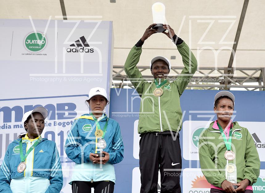 BOGOT&Aacute; -COLOMBIA. 28-07-2013. Priscah Jeptoo (Kenia) (center) con un tiempo de 1.12:24 fuen la ganadora en la Media Marat&oacute;n de Bogot&aacute; 2013 en la categor&iacute;a mujeres. En esta ocasi&oacute;n Geoffrey Kipsang (Kenia) fue el ganador en hombres con un tiempo de 1.03:46. / Priscah Jeptoo (Kenya) (center) was the winnwer of the Half Marathon of Bogota women category with a time of 1.12:24. In this edition Geoffrey Kipsang (Kenya) with a time of 1.03:46 in men category. <br /> list of winners women: <br /> 1. Priscah Jeptoo (Kenia): 1.12:24<br /> 2. In&eacute;s Melchor (Per&uacute;): 1.14:55<br /> 3. Amare Gobena (Etiop&iacute;a): 1.15:07<br /> 4. Flomena Chepchichir (Kenia): 1.15:21  Photo: VizzorImage / Str